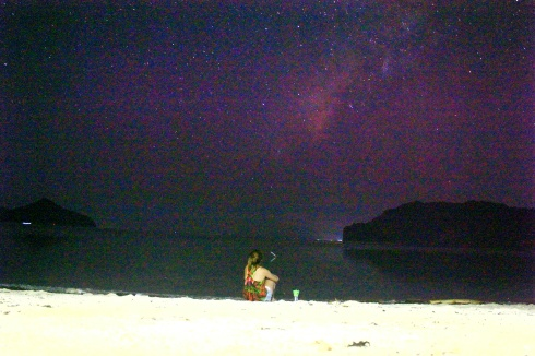 The beautiful pink and violet sky was littered with glittering stars that could only be visible in places like these.